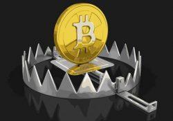 Bitcoin dans un piège en métal.