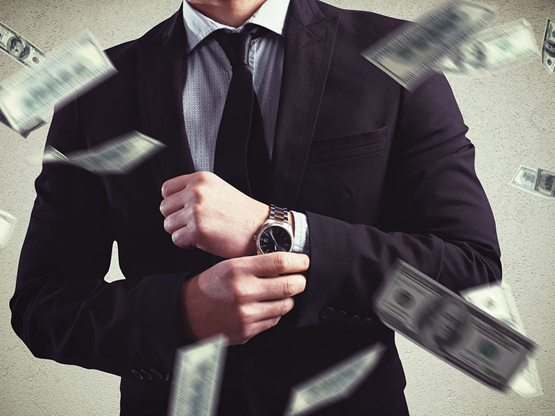 Jeune entrepreneur fortuné et billets de banque virevoltant autour.