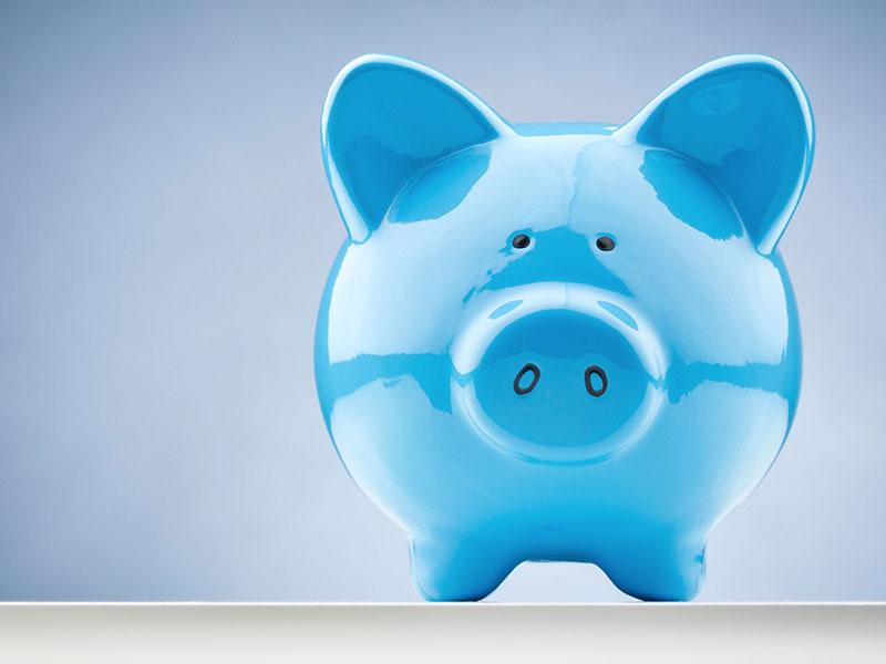 Tirelire bleue en forme de cochon.