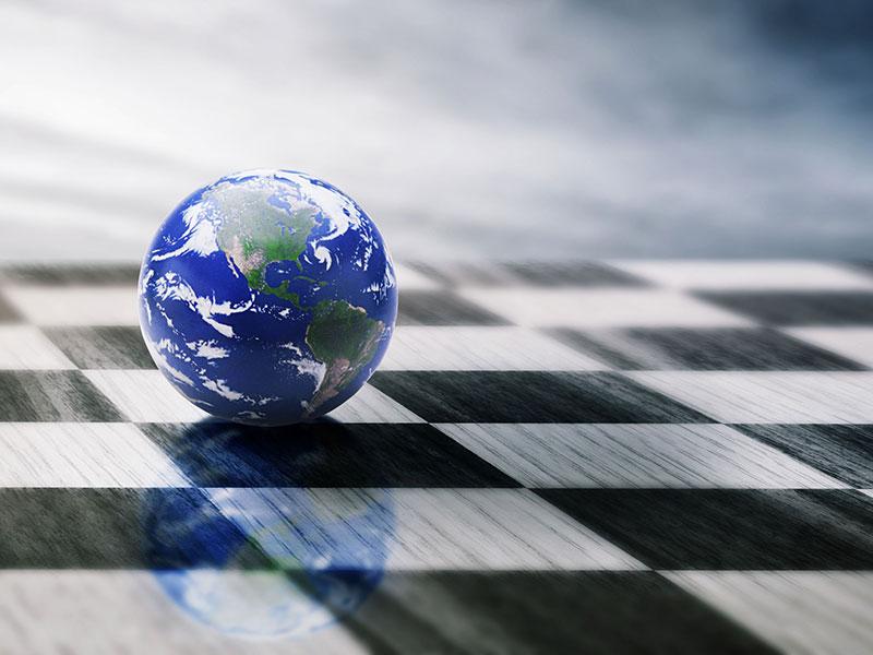 Damier noir et blanc sur lequel repose la Terre.