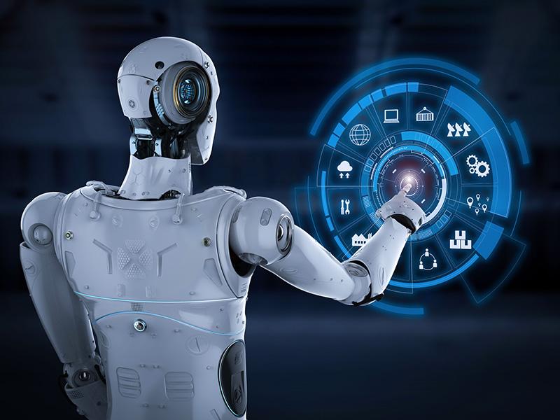 Robot devant un écran tactile.