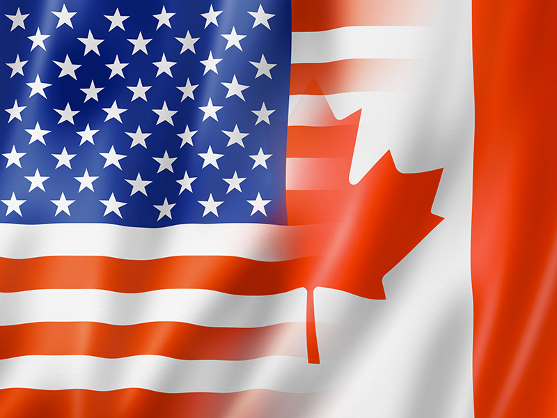 Drapeau américain et canadien se chevauchant.