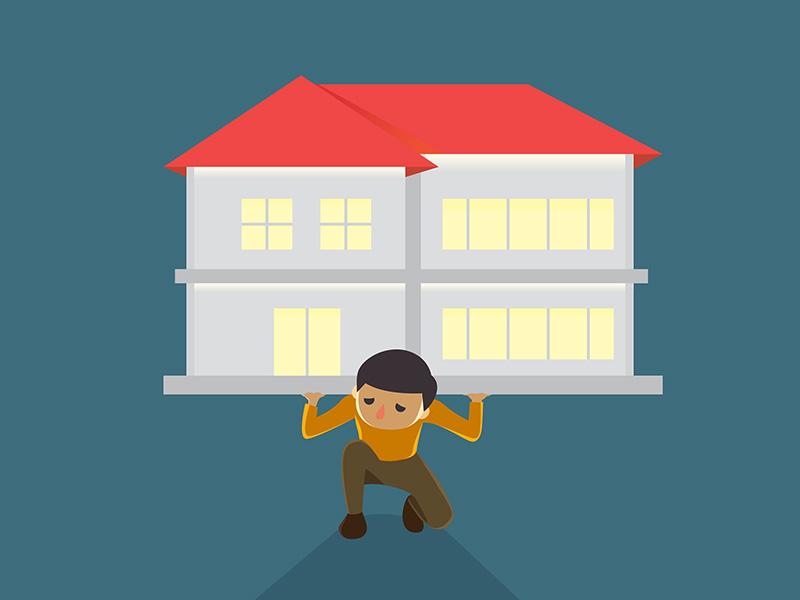 Homme supportant le poids de sa maison sur son dos.