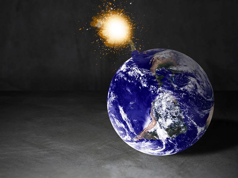 Planète terre prenant la forme d'une bombe.
