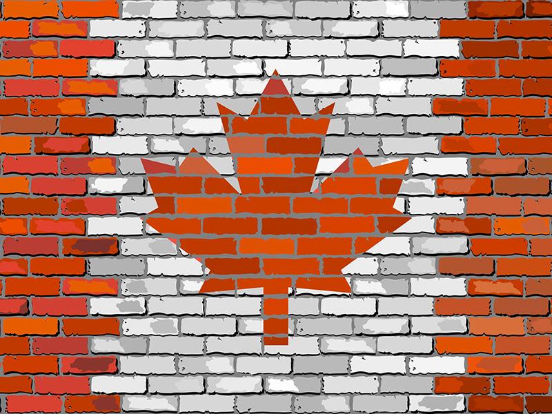 Mur de briques avec l'image du drapeau canadien.