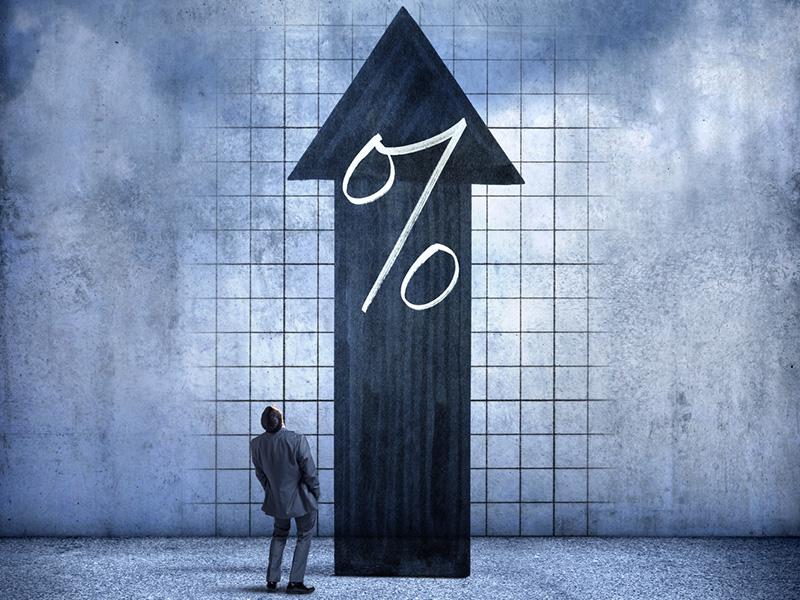 Flèche noire indiquant le haut et sur laquelle est apposé le symbole de pourcentage.