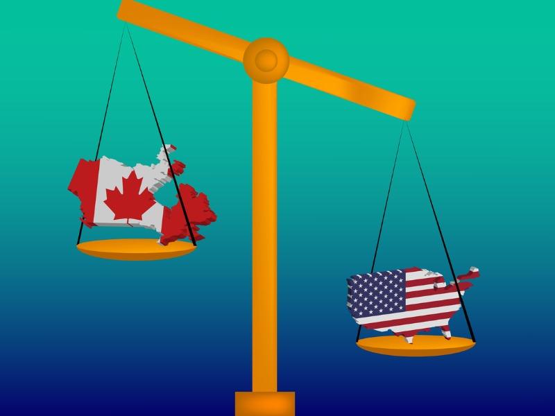 Le Canada et les USA sont sur une balance. Le Canada est plus haut que les USA.